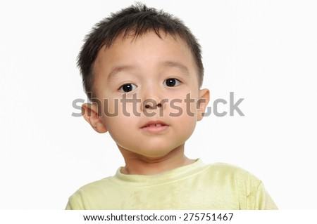 cute young happy boy in studio - stock photo