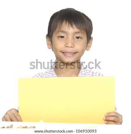 Cute young happy preschooler boy holding up blank sign with room for copy - stock photo