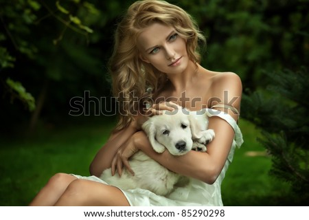 Cute young lady and a puppy dog - stock photo