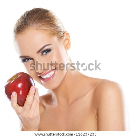 Cute young lady holding red apple while isolated on white - stock photo