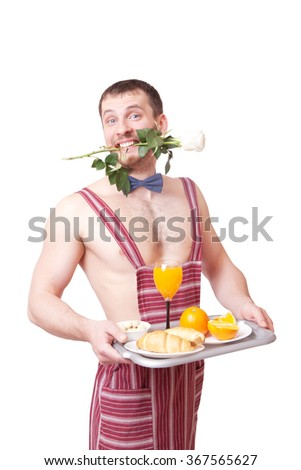 Cute young man holding a tray of food and a rose in his teeth - stock photo