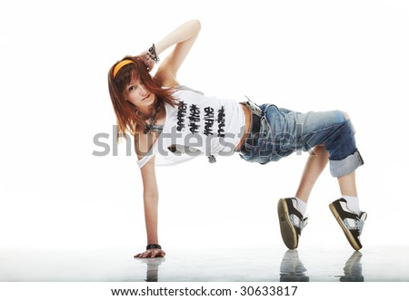 Cute Young woman dancing on white floor - stock photo
