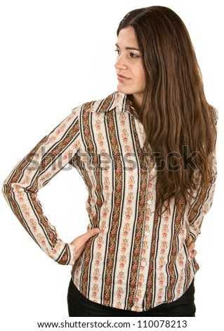 Cute young woman looking sideways with hands on hips - stock photo