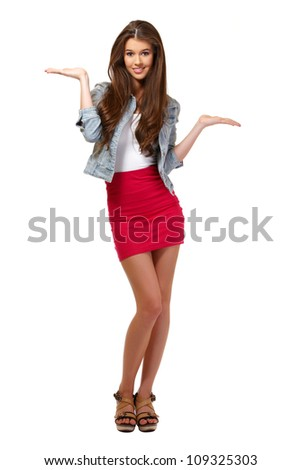 cute young woman posing in studio - stock photo