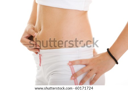 cute young woman touching her fat around the stomach - stock photo