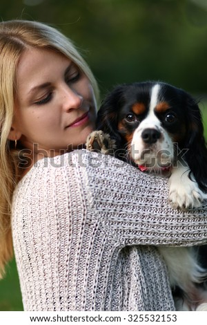 cute young woman with dog  in park - stock photo