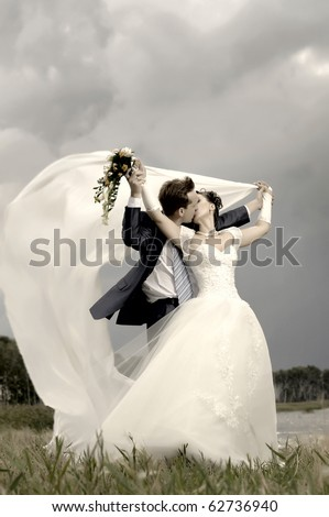 cutie happy married  couple  on nature, puff wind, hot kiss - stock photo