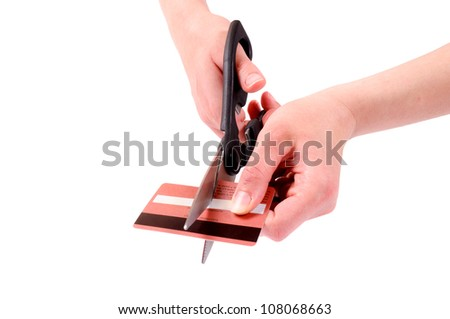 Cuting the credit card - stock photo