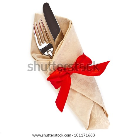 cutlery and napkin with red ribbon bow isolated on white - stock photo