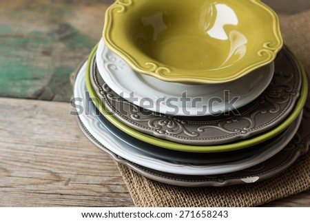 Cutlery, crockery and mugs ready to be set for a meal - stock photo