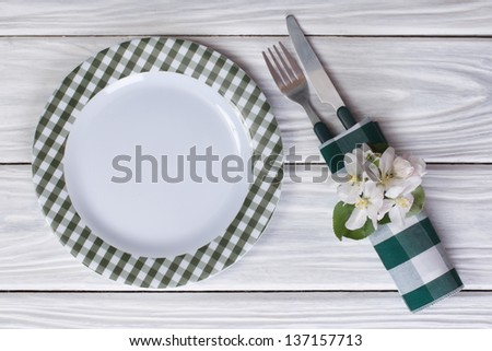 cutlery decorated with flowers of apple on a table. Top view. - stock photo