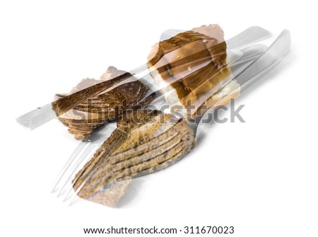 cutlery fork golden color and fried bread - stock photo