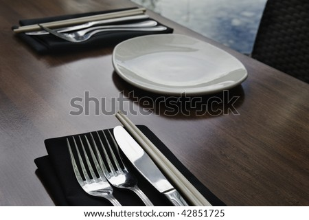 cutlery in a asian fusion restaurant - stock photo