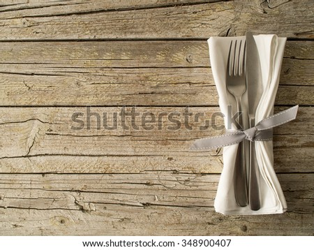 Cutlery kitchenware on old wooden boards background food concept - stock photo
