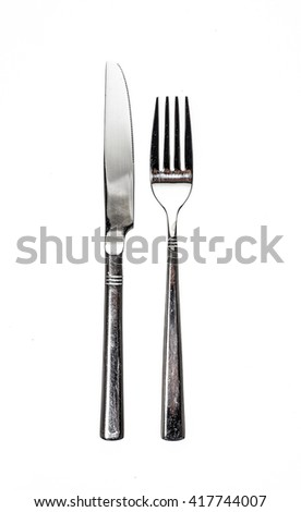 Cutlery metal set with Fork and Knife - kitchen utensils. Isolated on white background - stock photo