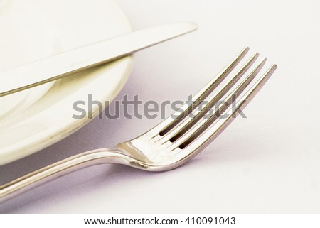 Cutlery on a side plate high key - stock photo