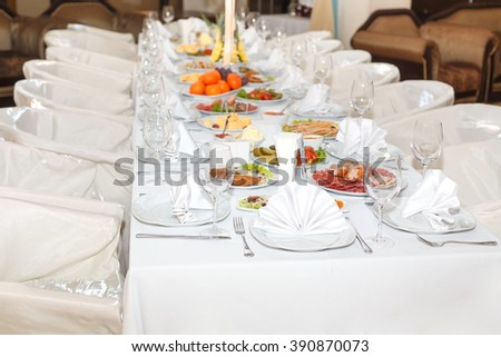 cutlery on the white banquet table in restaurant - stock photo