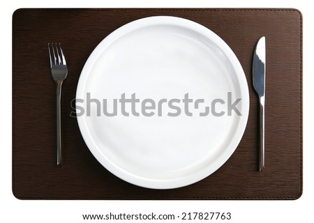 Cutlery Set with plate and tablemat isolated On white  - stock photo