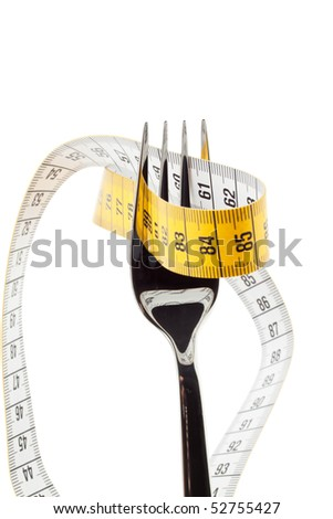 Cutlery with tape. Symbol for diet and weight loss. - stock photo