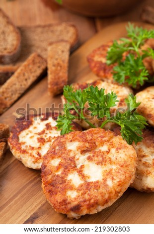 Cutlets on the wooden desk - stock photo