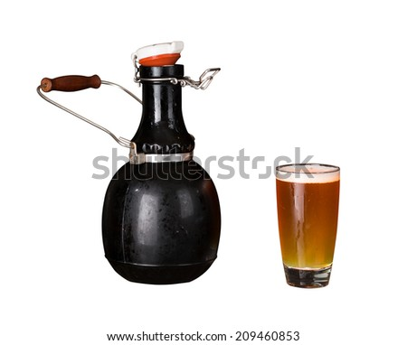 Cutout of a large 64 fluid ounce four pint growler bottle with a glass of cold beer or ale. Used by microbreweries to serve beer for home consumption - stock photo
