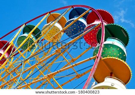 cutout of a retro Ferris wheel over the sky - stock photo