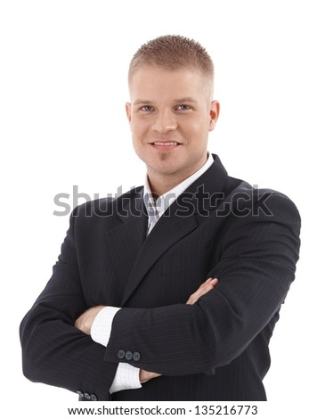 Cutout portrait of smiling businessman standing with arms folded, looking at camera. - stock photo