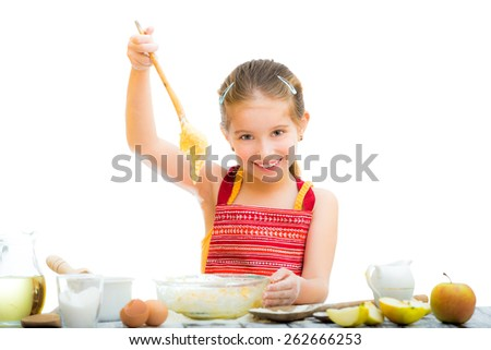 cutre funny little girl making dough isolated on a white background - stock photo
