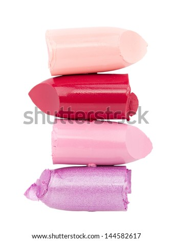 Cutted color lipsticks closeup on white background - stock photo