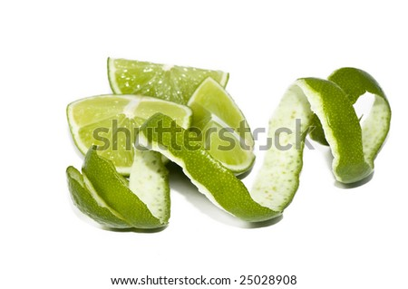 cutted lime and its rind cutout in spiral form - stock photo