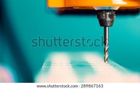 Cutter CNC router and plastic parts of Plexiglas - stock photo