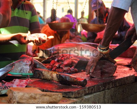 Cutting and sailing the tuna on the traditional fish market in Colombo, Sri Lanka, South Asia  - stock photo