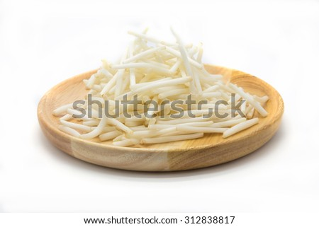 Cutting bean sprouts on wooden disk, white background - stock photo