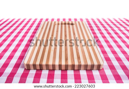 Cutting board on kitchen table - stock photo