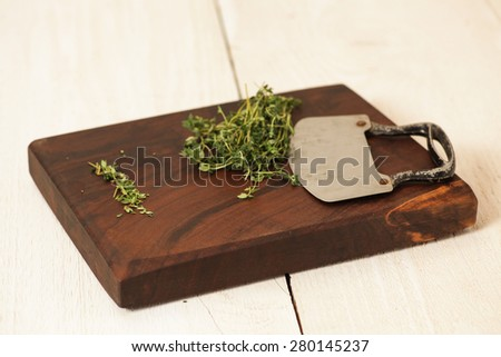 Cutting board with Rosemary herbs - stock photo