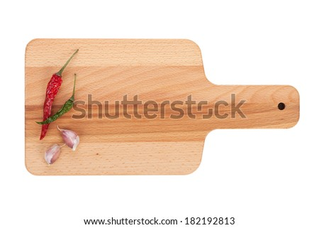 Cutting board with spices. Isolated on white background - stock photo