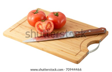 Cutting board with three tomatoes isolated on white a white background - stock photo