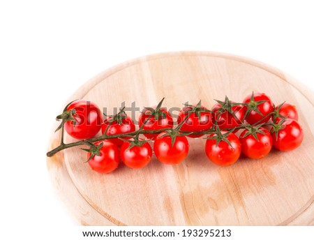 Cutting board with tomatoes-cherry. Close up. Whole background. - stock photo