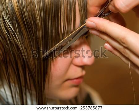 Cutting hair at the hair salon - stock photo