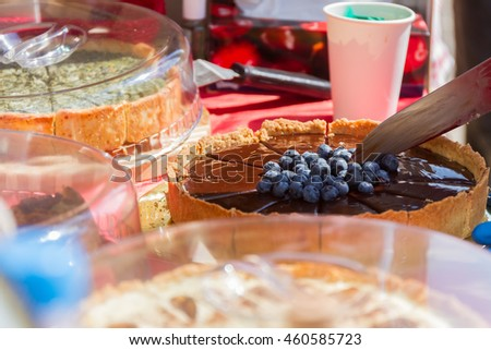 cutting homemade fresh delicious pie - stock photo