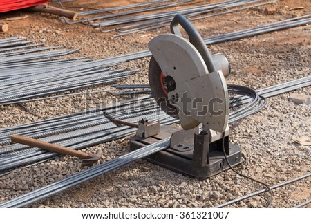 Cutting metal with grinder. Sparks while grinding iron - stock photo
