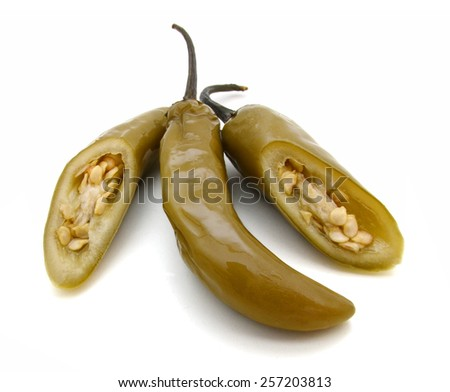 cutting of preserved Jalapeno pepper on a white background  - stock photo