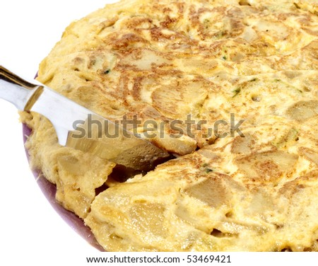 Cutting spanish omelet isolated in white - stock photo