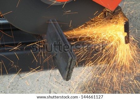 cutting steel with grinder machine close up - stock photo
