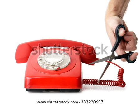 Cutting telephone cord isolated on a white background - stock photo