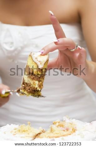Cutting the wedding cake - stock photo