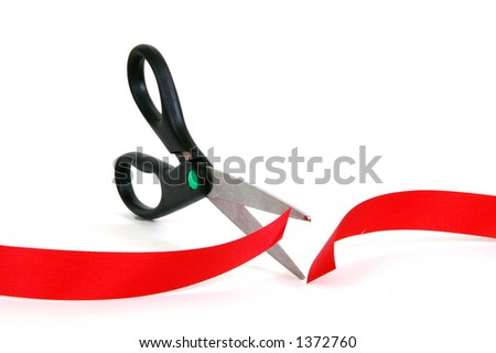Cutting through the red tape - stock photo