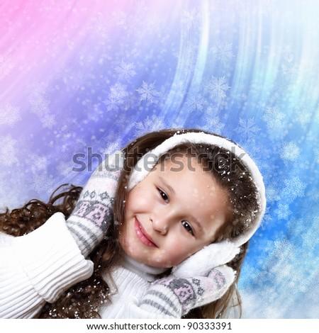 Cuty little girl in winter wear happy about new year - stock photo