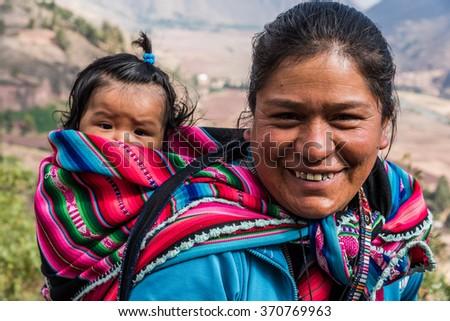 CUZCO, PERU - CIRCA 2015: Portrait  of a unidentified woman and children circa 2015, in Cuzco, Peru.  - stock photo