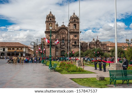 CUZCO, PERU - JULY 14: army parade in the Plaza de Armas at Cuzco Peru on july 14th, 2013. This plaza has been the scene of the proclamation by Francisco Pizarro in the conquest of Cuzco - stock photo